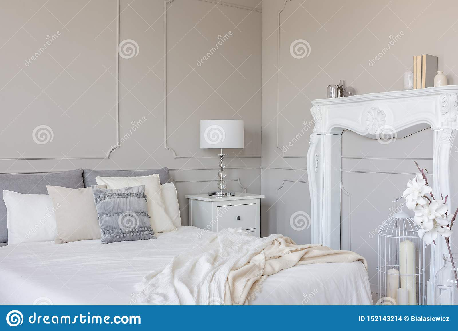 Picture of: White Wooden Fireplace Portal In Beautiful Bedroom Interior With White Sheets On King Size Bed Stock Photo Image Of Duvet Estate 152143214
