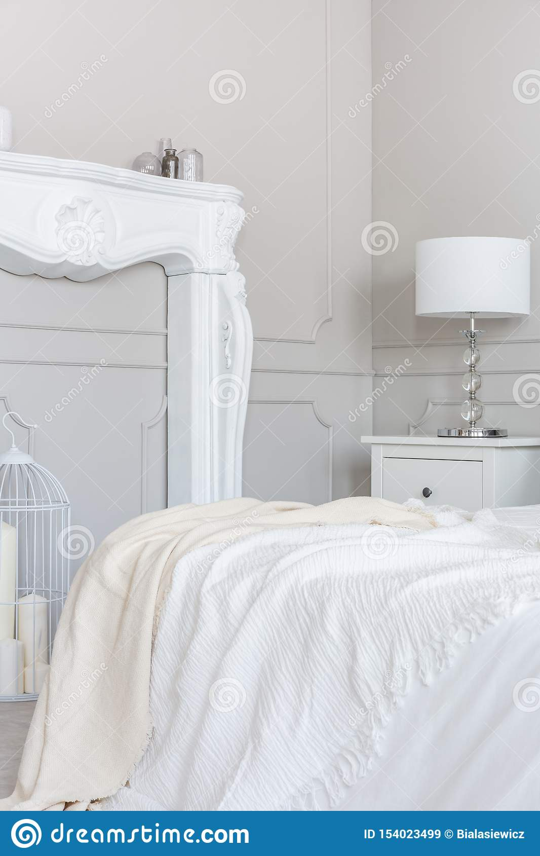 Picture of: White Wooden Fireplace Portal In Beautiful Bedroom Interior With White Sheets On King Size Bed Stock Image Image Of Floor Decor 154023499