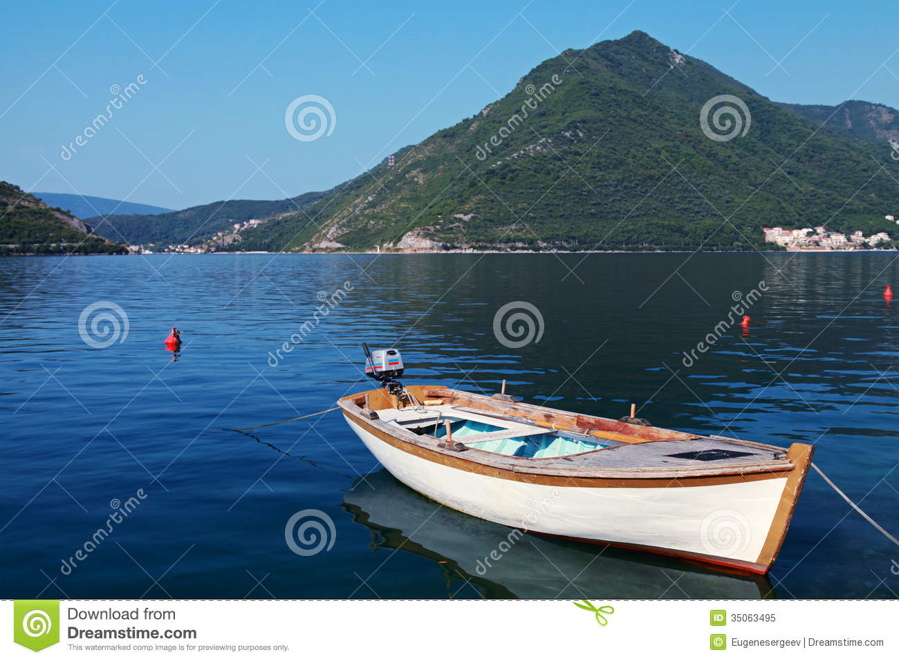 White wooden fishing boat in perast town stock image for Sea fishing boats