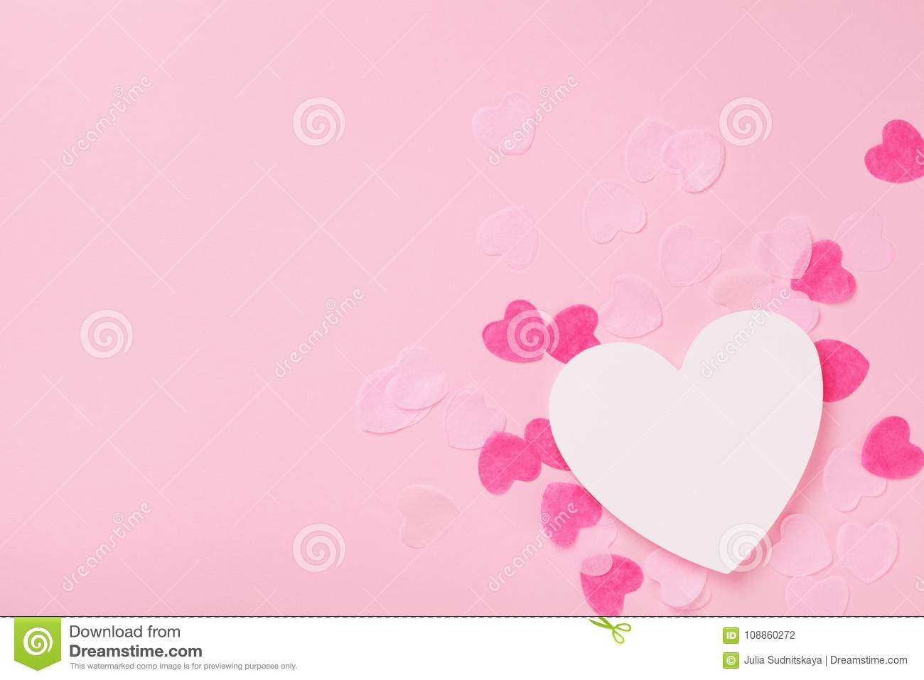 White wooden heart and paper hearts on pink pastel background top view. Greeting card for Valentines, Woman or Mothers Day.