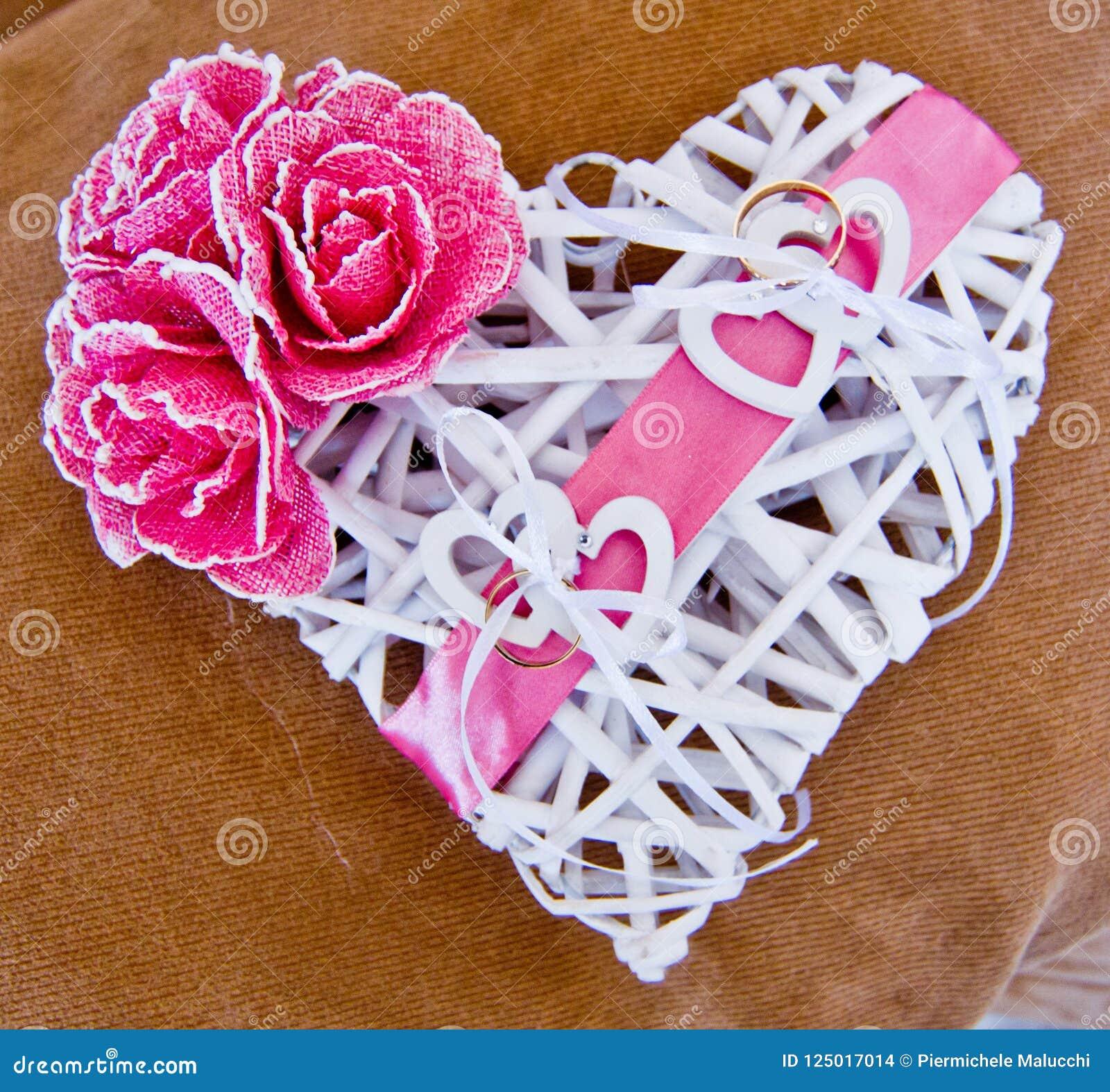 Wedding Rings On White Heart Stock Photo - Image of golden, jewel ...