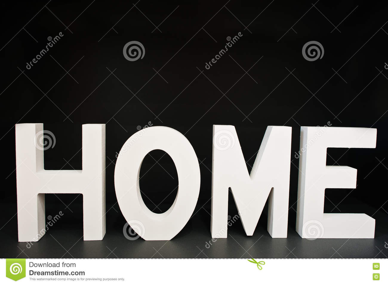 white wooden letters home at black background