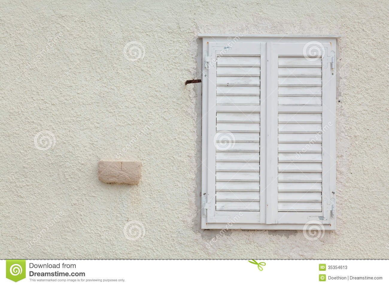 White Wooden Window With Closed Slatted Shutters Stock