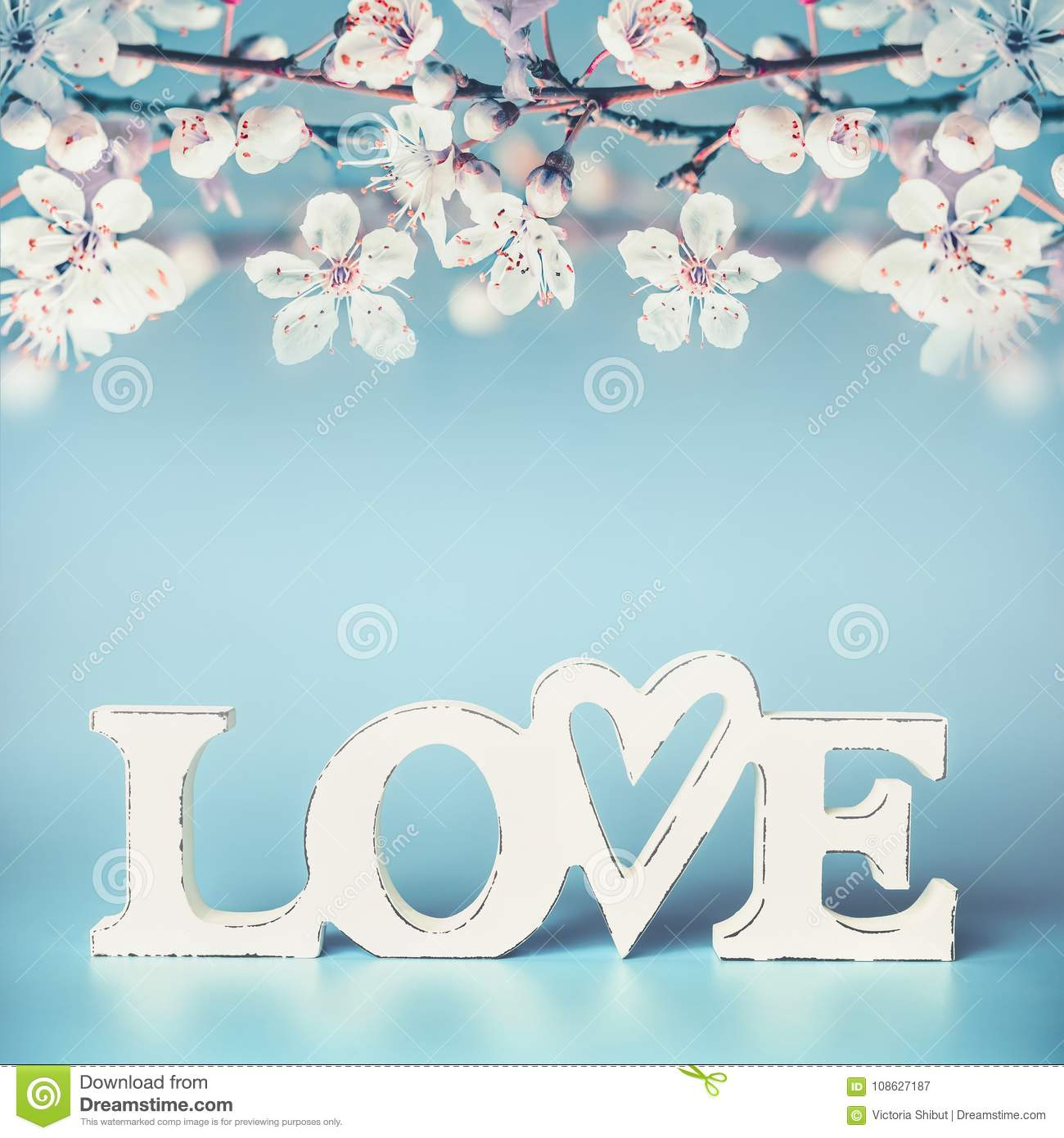 White Word Love With Pastel Spring Blossom On Turquoise Blue