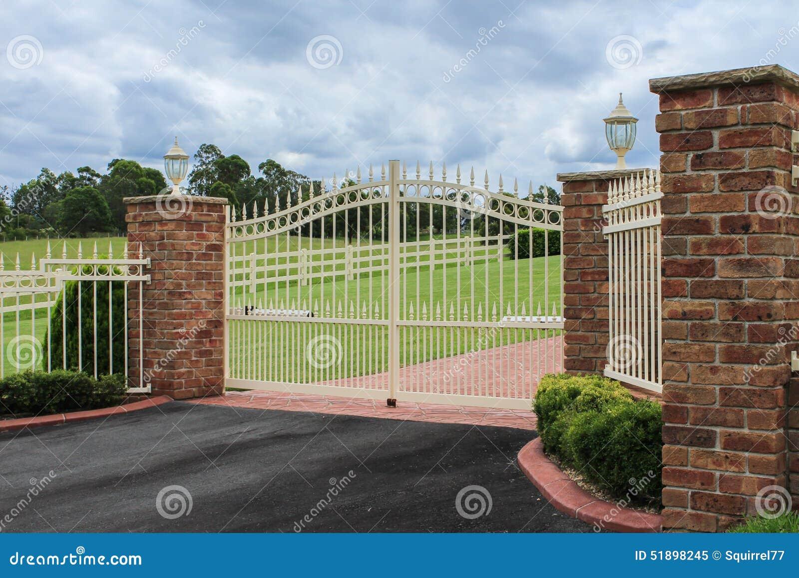 White Wrought Iron Driveway Entrance Gates Stock Image