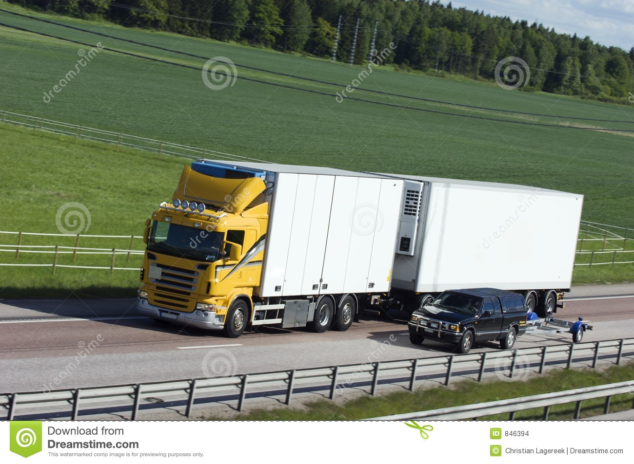 White and yellow lorry in the countryside