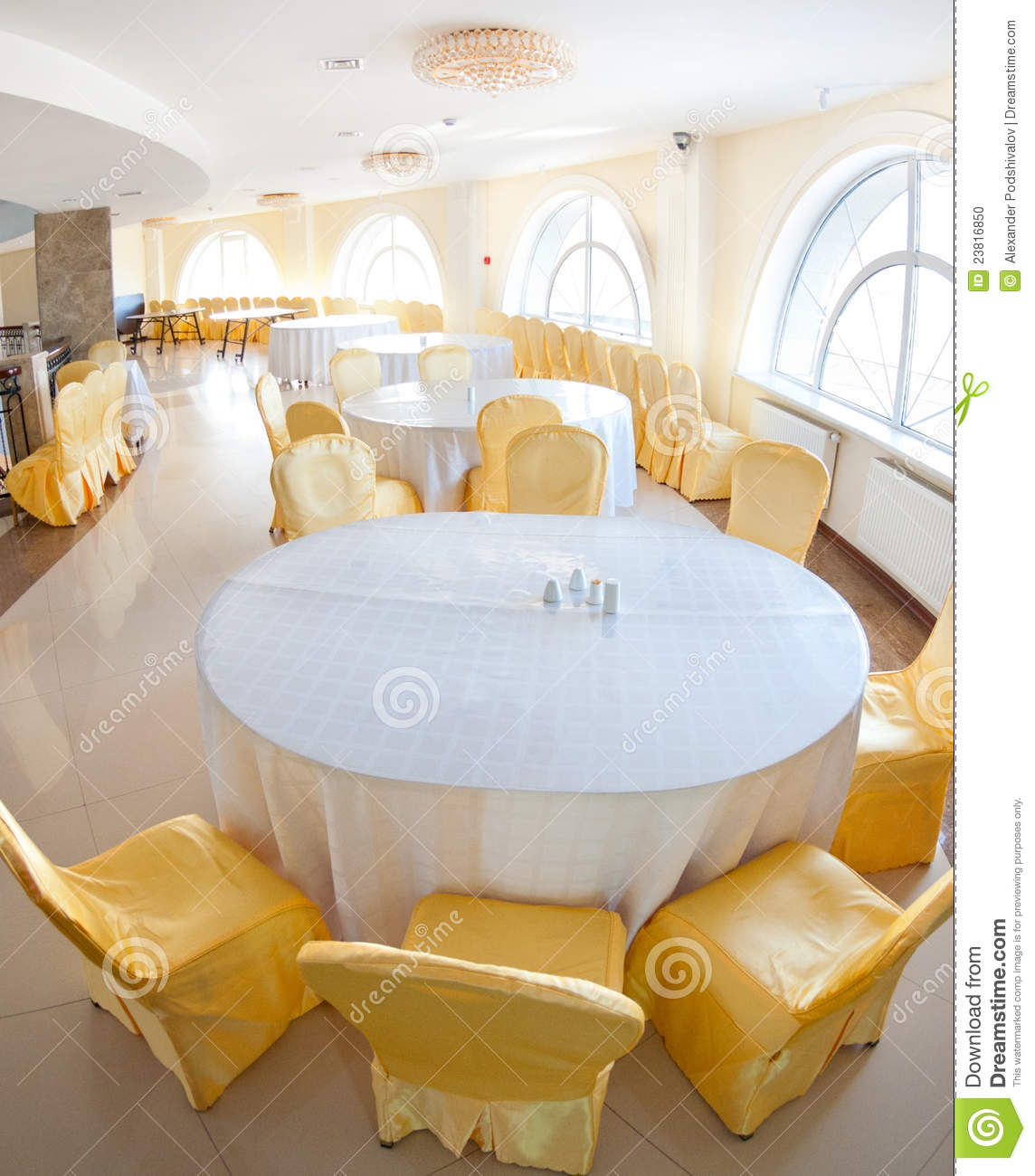 White and yellow restaurant interior stock photo image