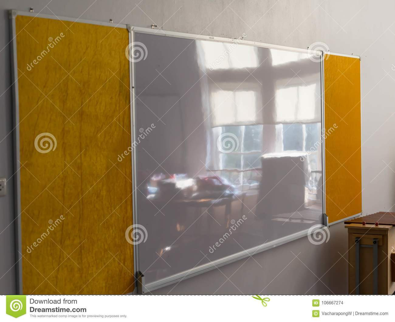 Whiteboard at wall with beside window reflect