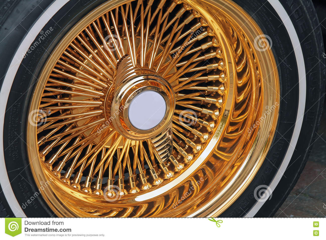 closeup fancy gold tire whitewall
