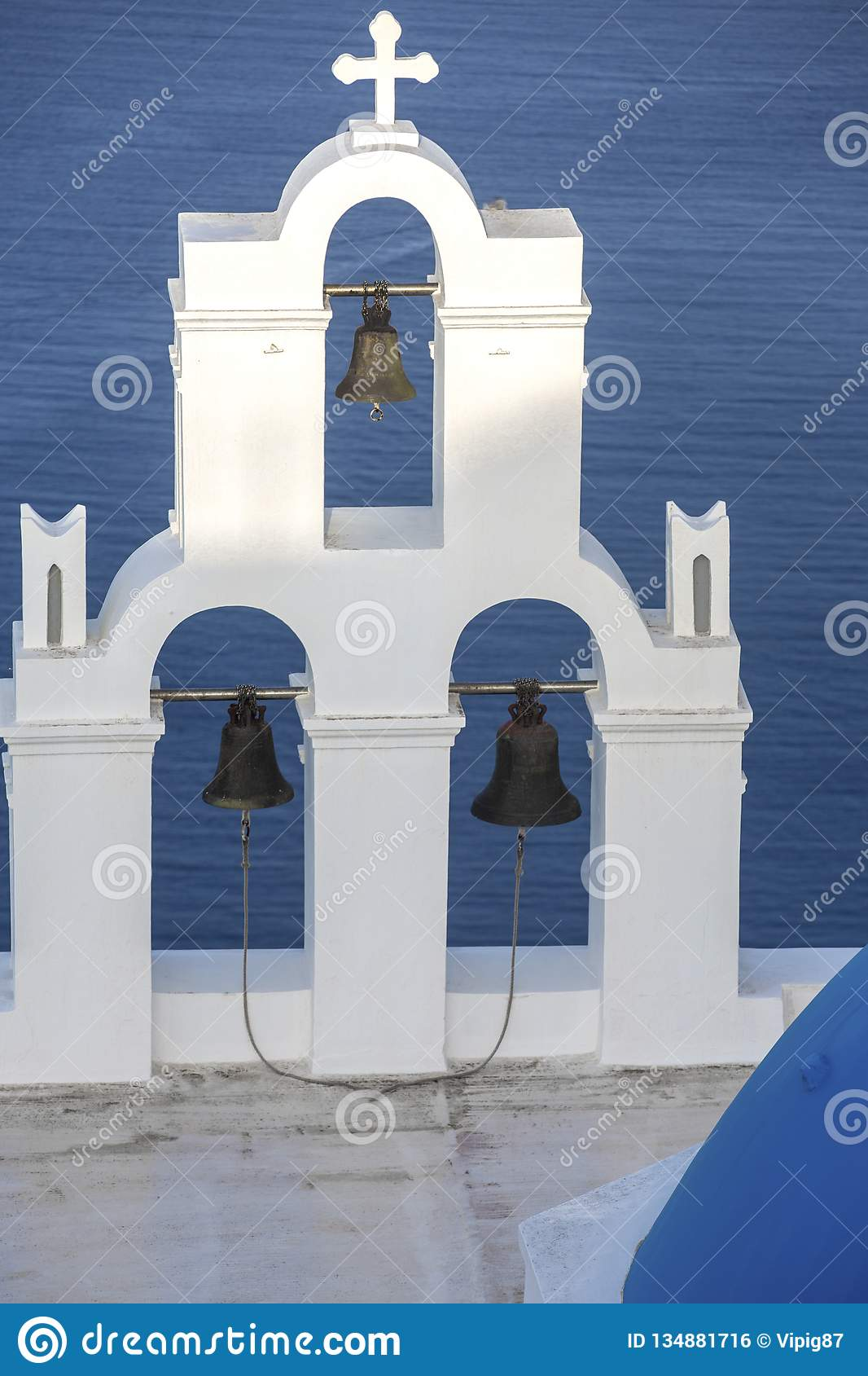 Whitewashed houses and blue dome church by the Aegean sea, Santoriniin Oia, Santorini, Greece. Famous blue domes in Oia village,