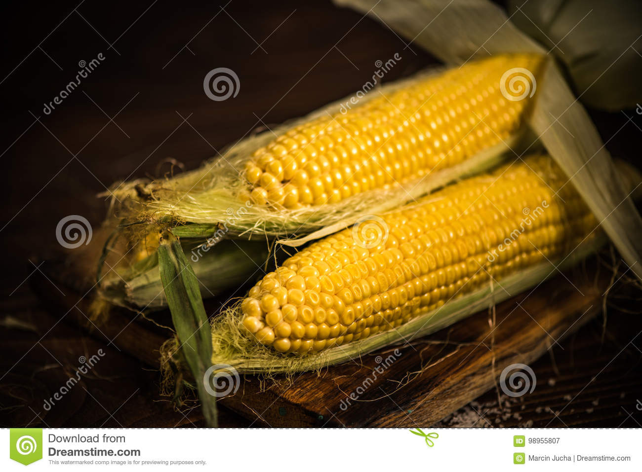 Whole Corn On The Cob On Wooden Board Stock Image