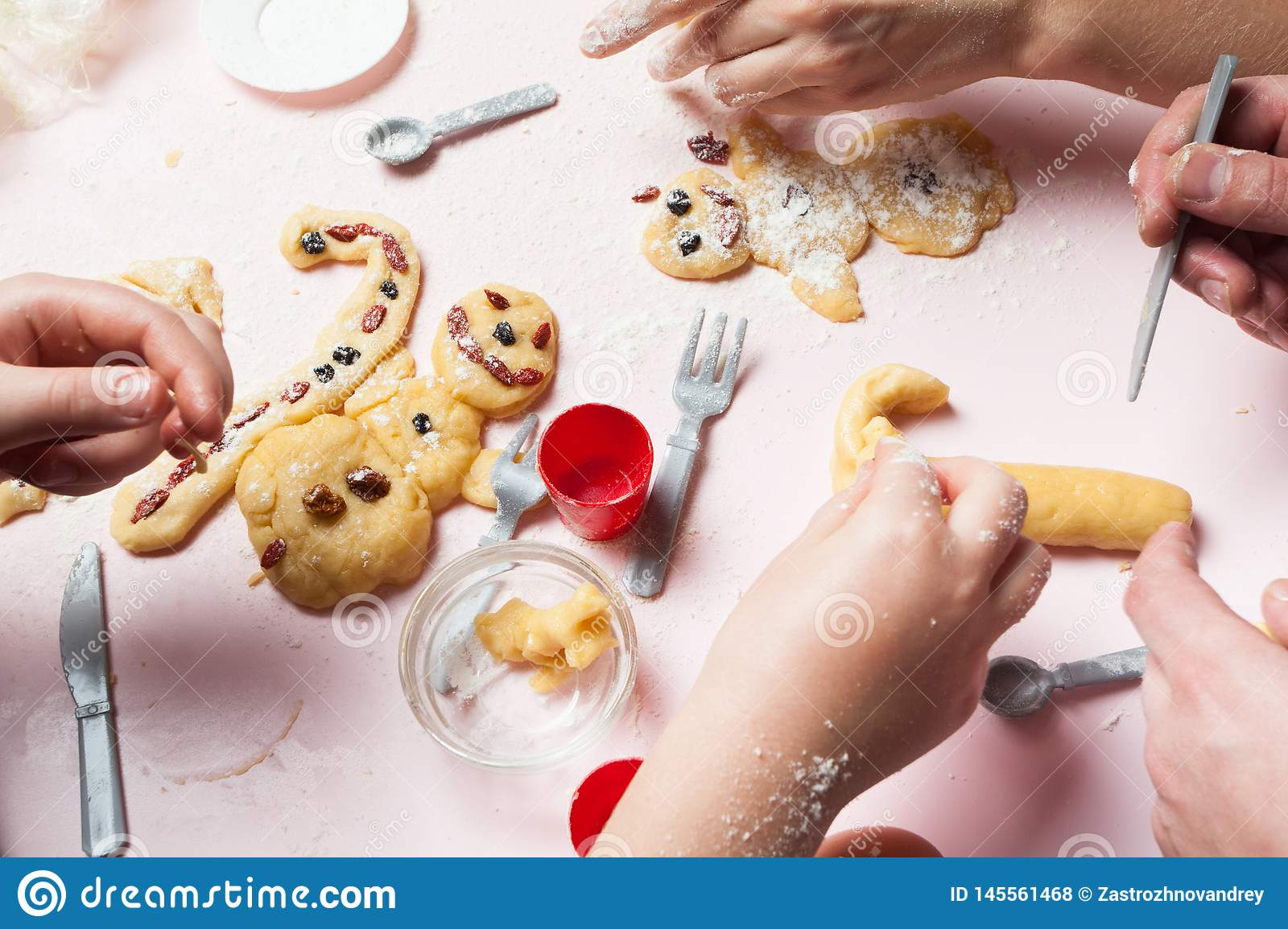 The whole family is preparing Christmas buns. Christmas cookies and gingerbread in the form of snowmen. Preparing for Christmas