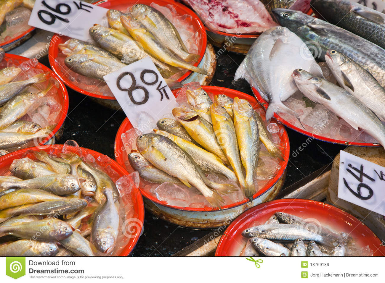 Whole fresh fishes are offered in the fish market royalty for Fresh fish market miami