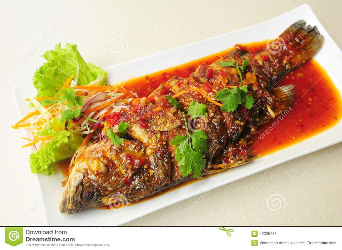 Whole fried fish topped with sweet chili sauce stock photo for Deep fried whole fish