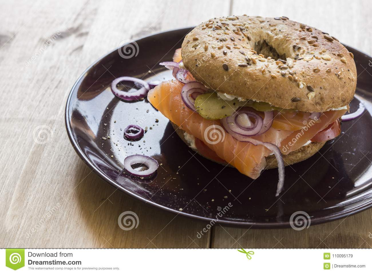 Whole Grain Bagel With Salmon, Cream Cheese, Onions And