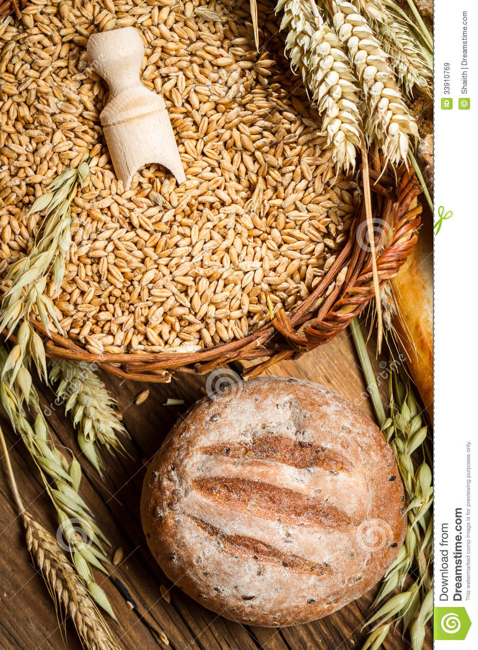 Whole grain bread with a basket full of grains