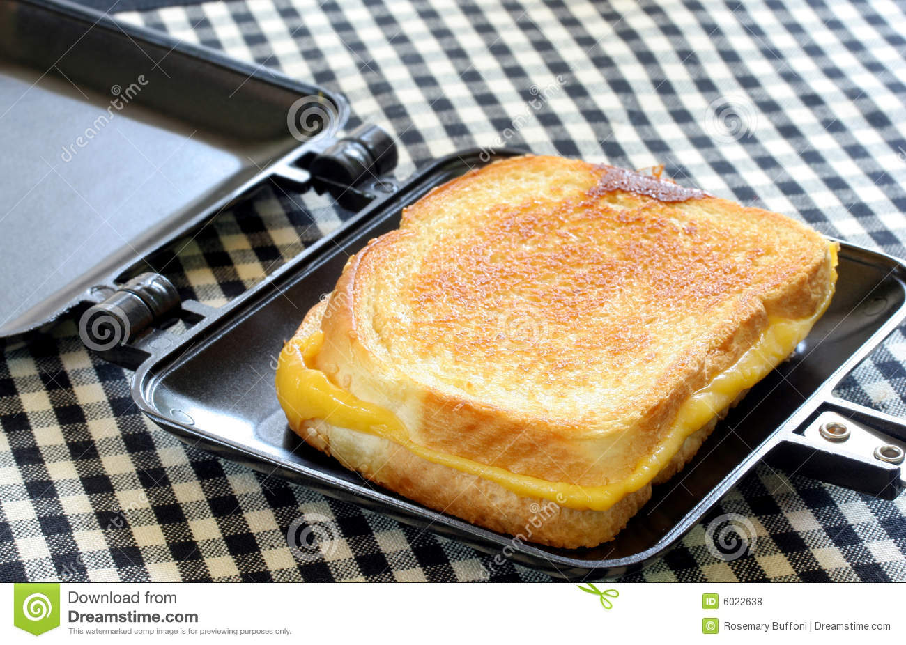 whole grilled cheese in sandwich maker royalty free stock. Black Bedroom Furniture Sets. Home Design Ideas