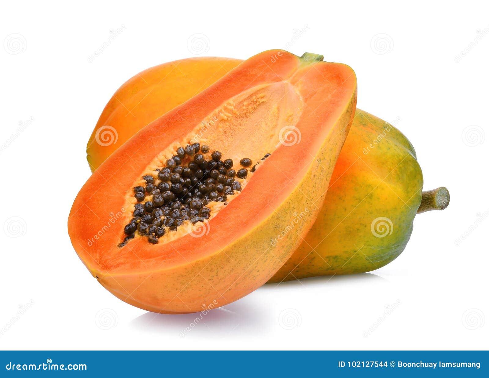 Whole and half of ripe papaya fruit with seeds on white