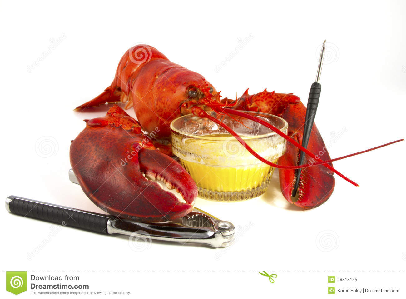 Whole lobster with drawn butter and eating implements isolated on ...