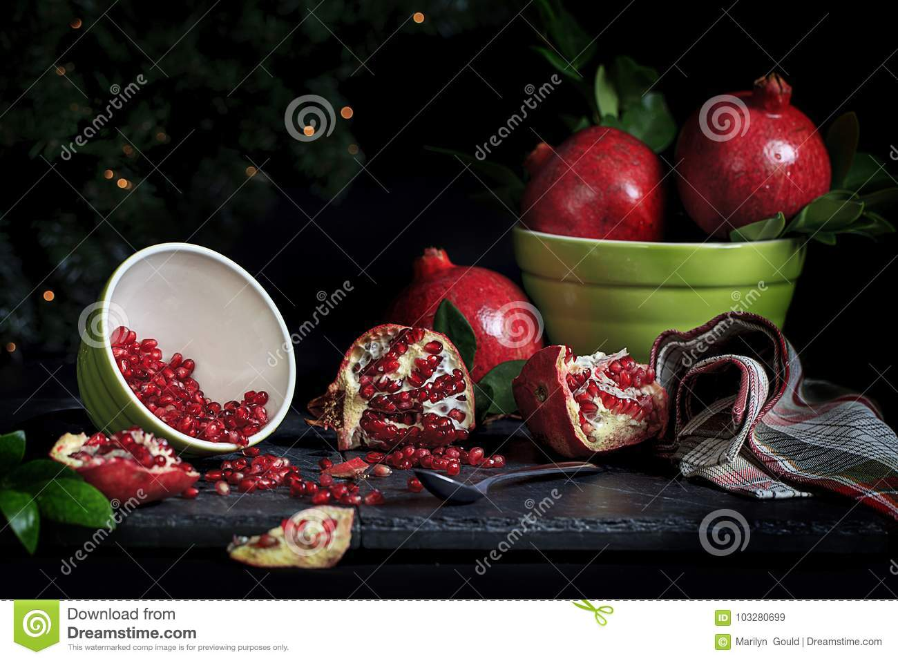 Whole Pomegranates and Seeds in Bowl
