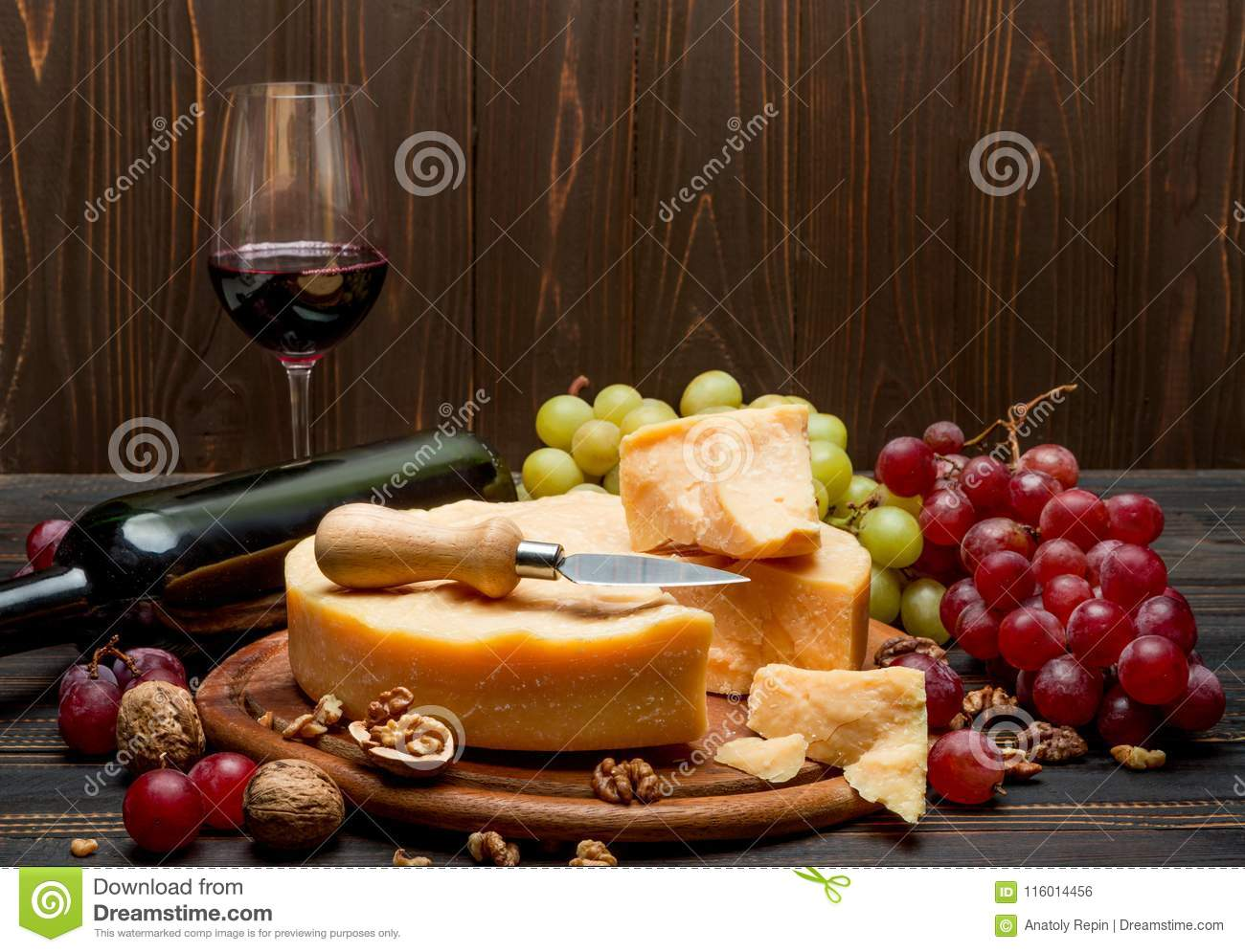 Whole Round Head Parmesan Cheese Wine And Grapes Stock Photo