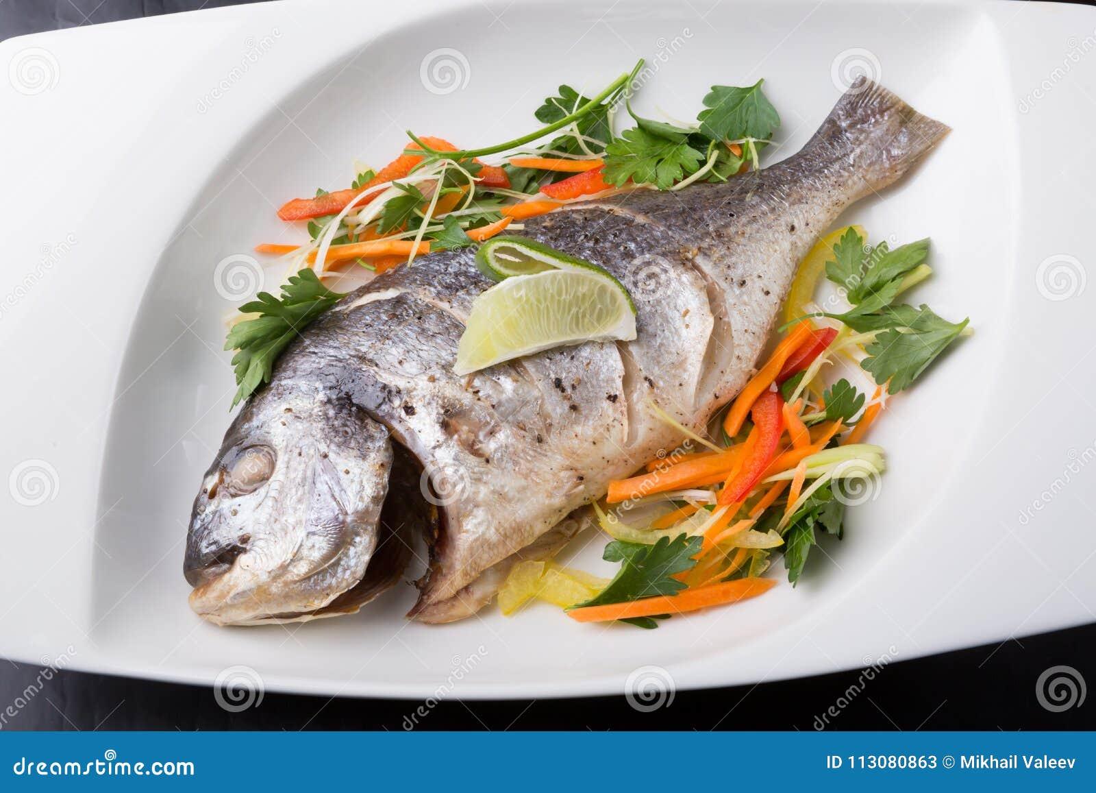 Whole steamed dorado fish