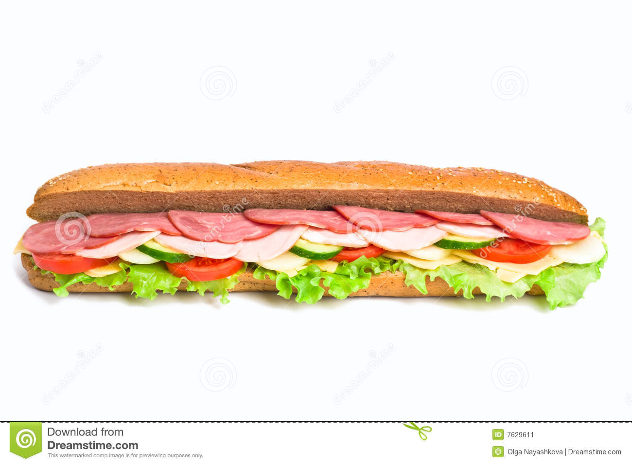 long whole wheat baguette sandwich with lettuce, slices of fresh ...