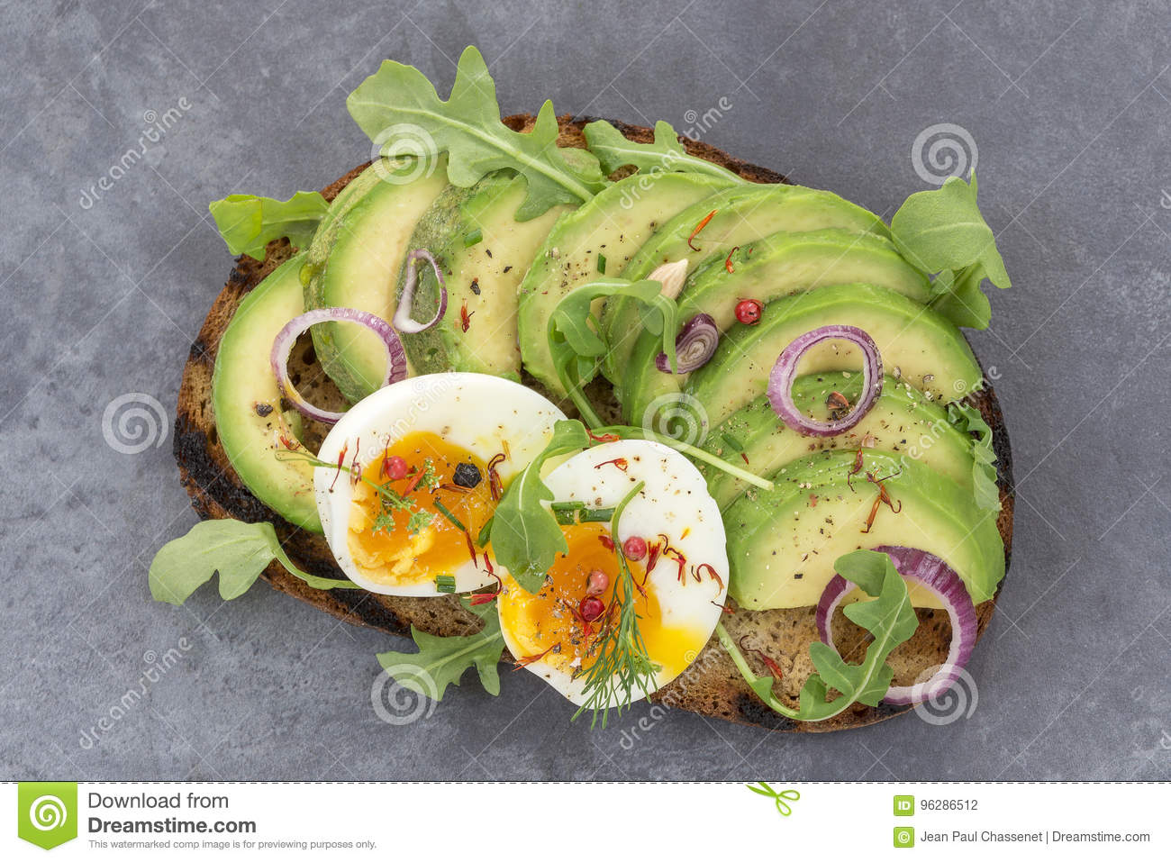 Whole Wheat Bread Avocado Poached Egg Sandwich With Fresh Herbs