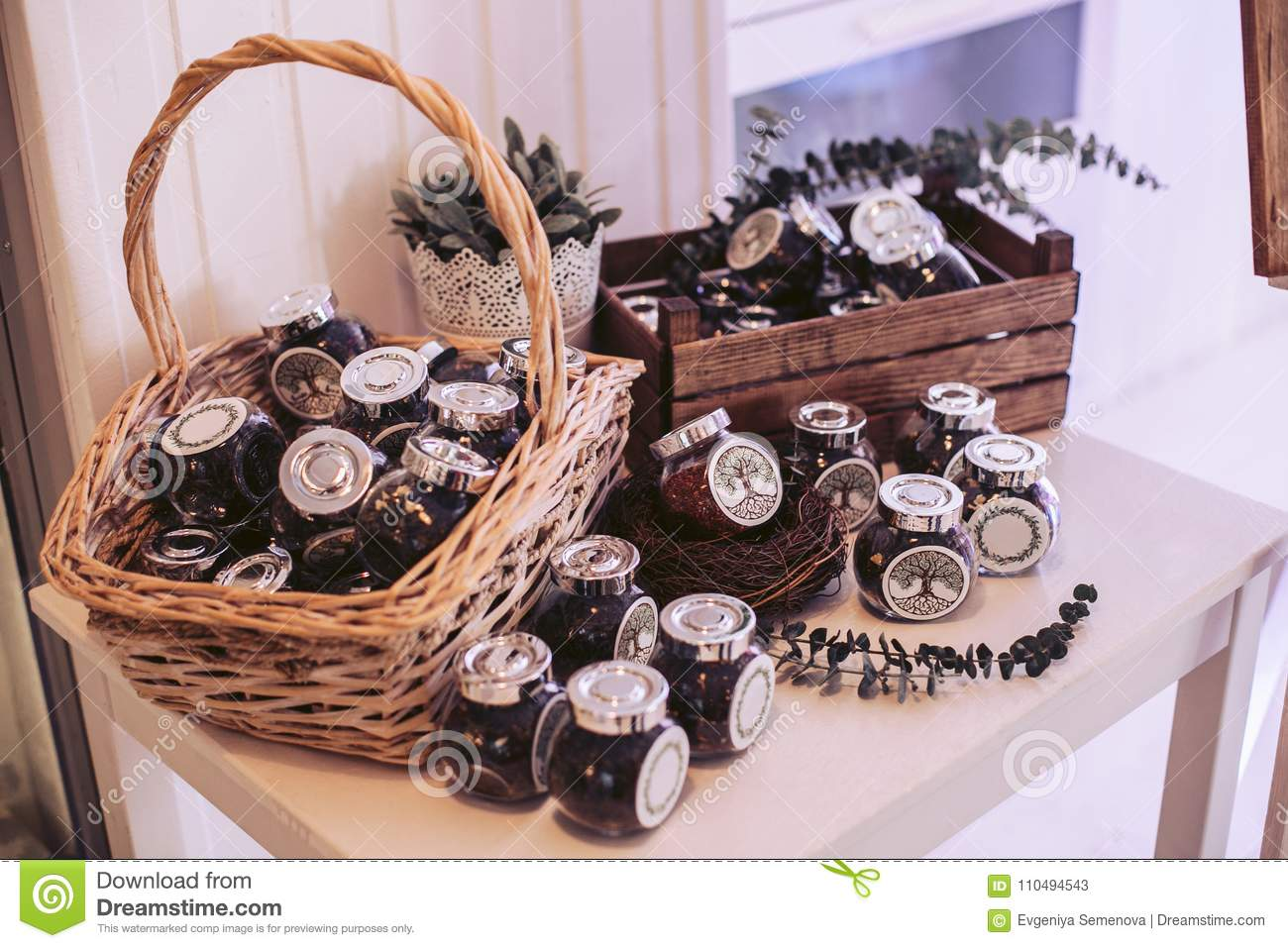 Wicker Basket And Box With Glass Jars Filled Decorative Elements