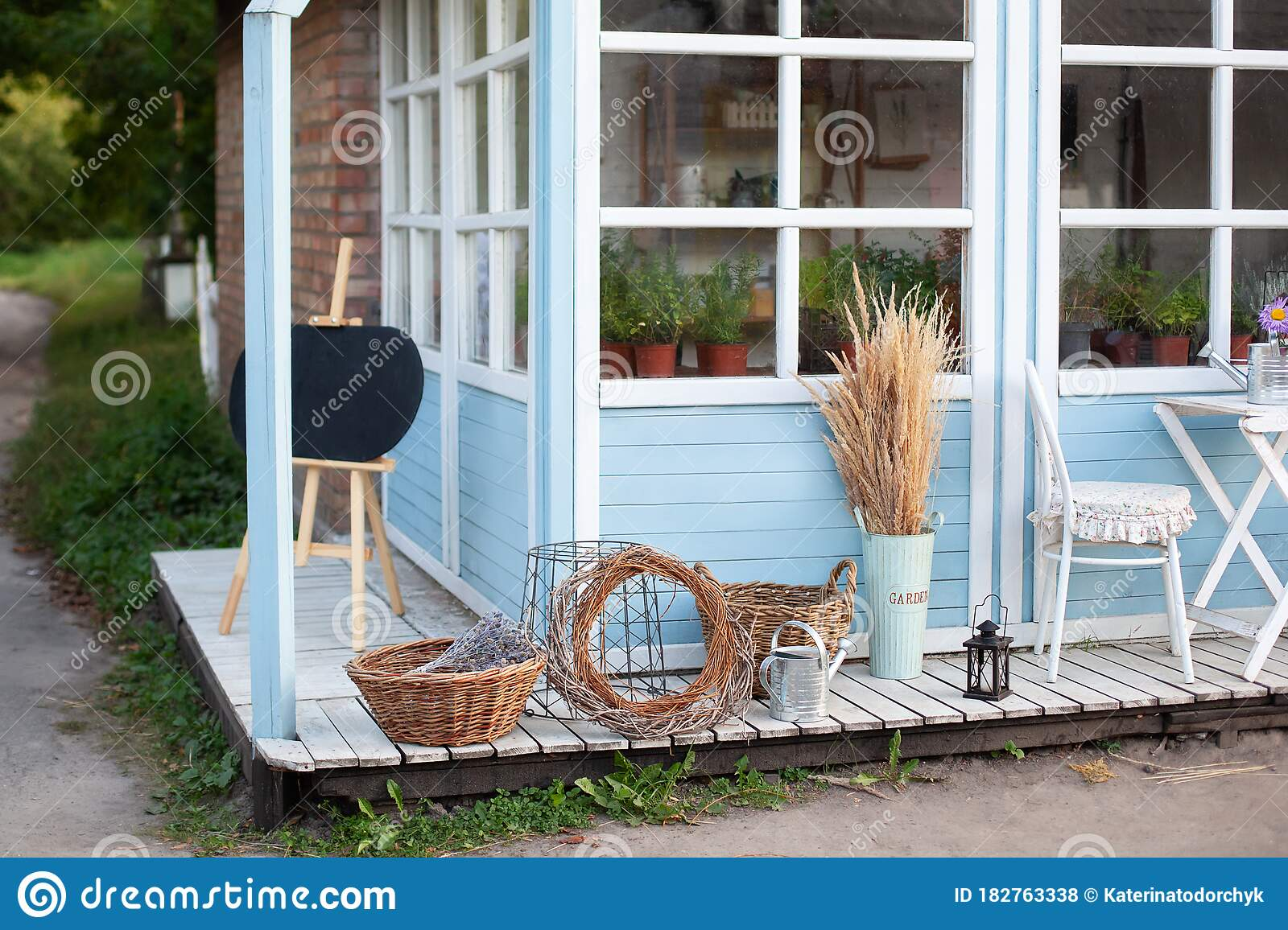 Wicker Baskets Next To Garden Equipment By Wall Of House. Decor Of