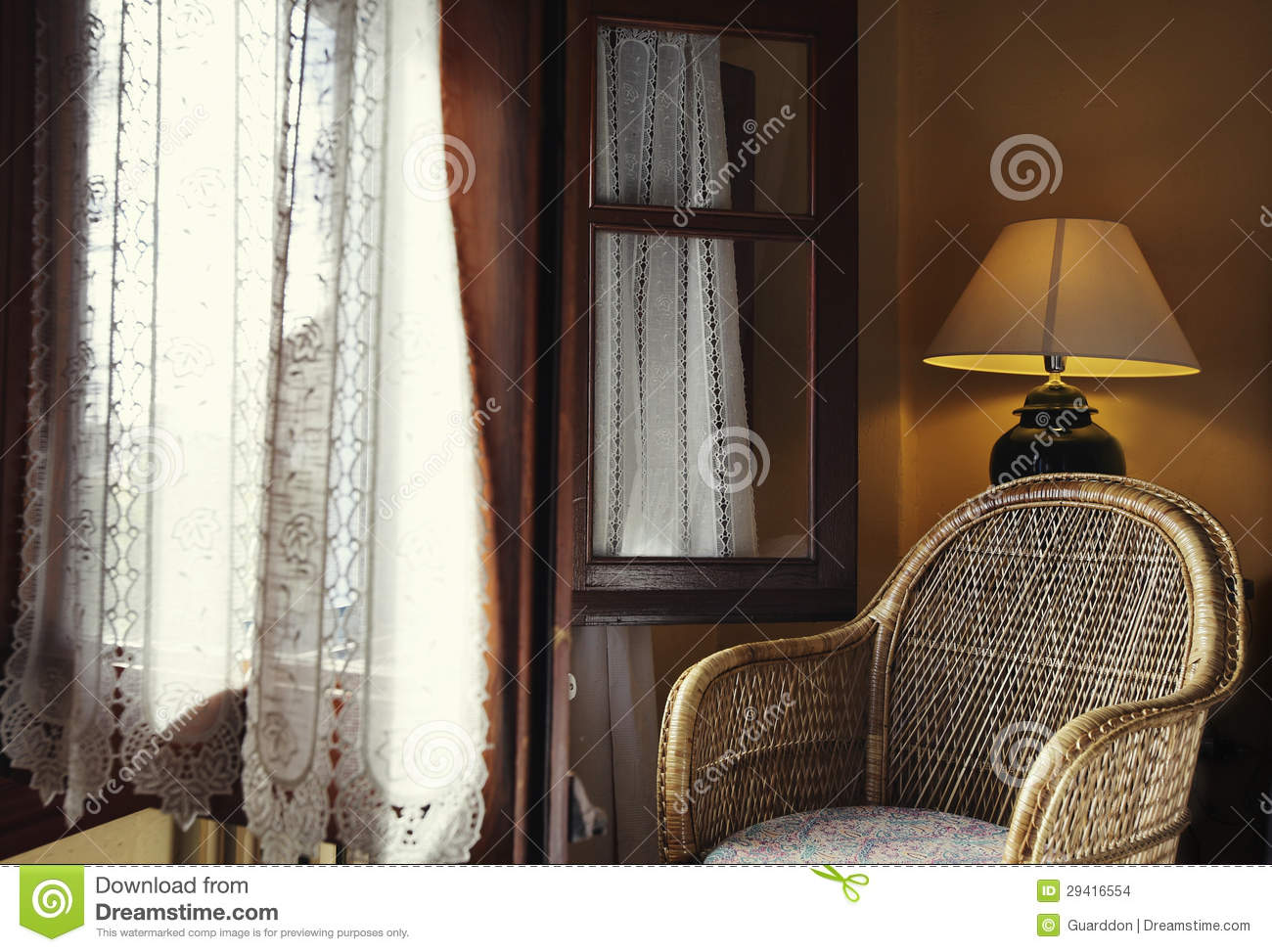 wicker chair next to window stock images image 29416554