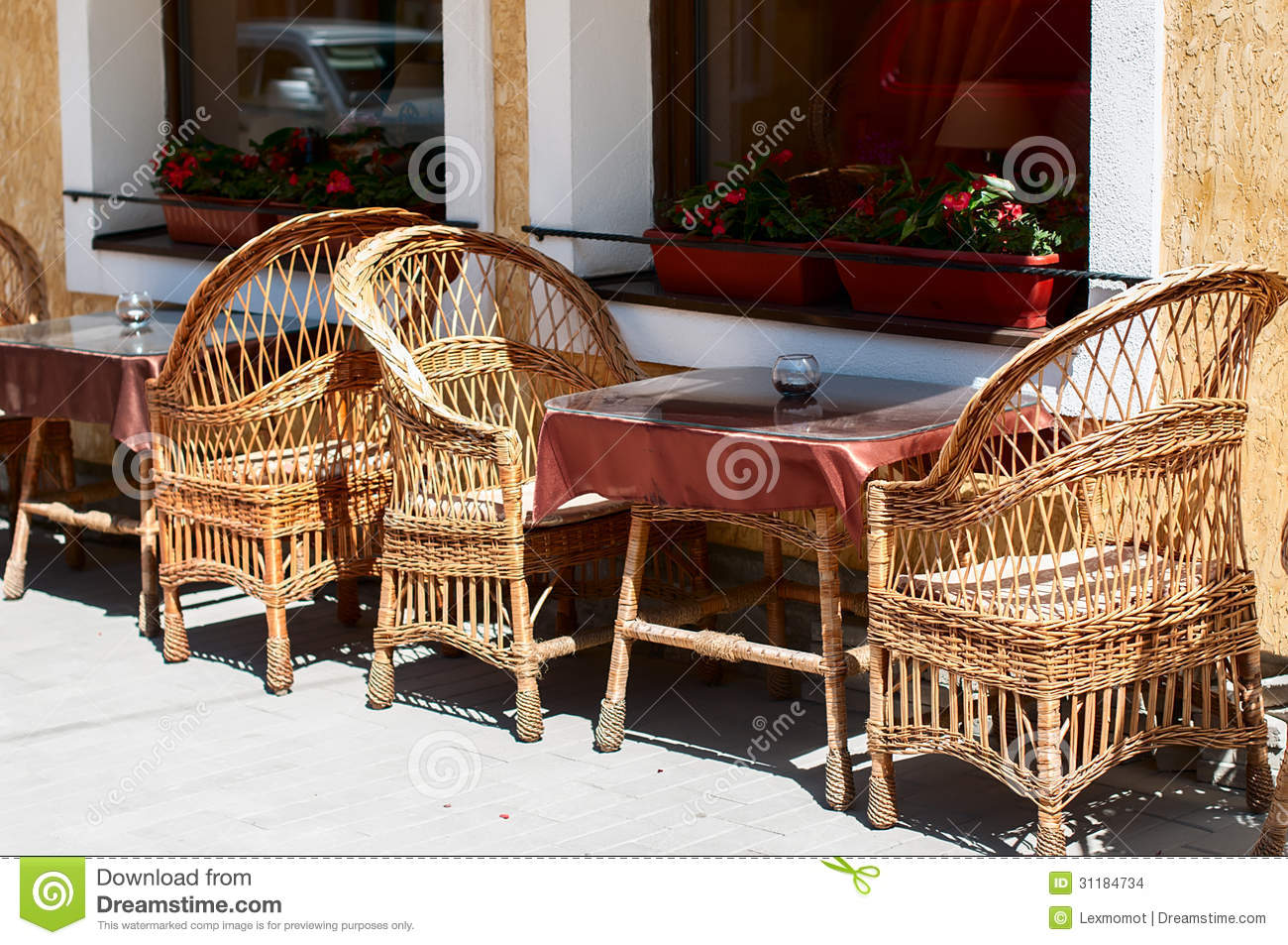 Wicker furniture in cafe outdoors.