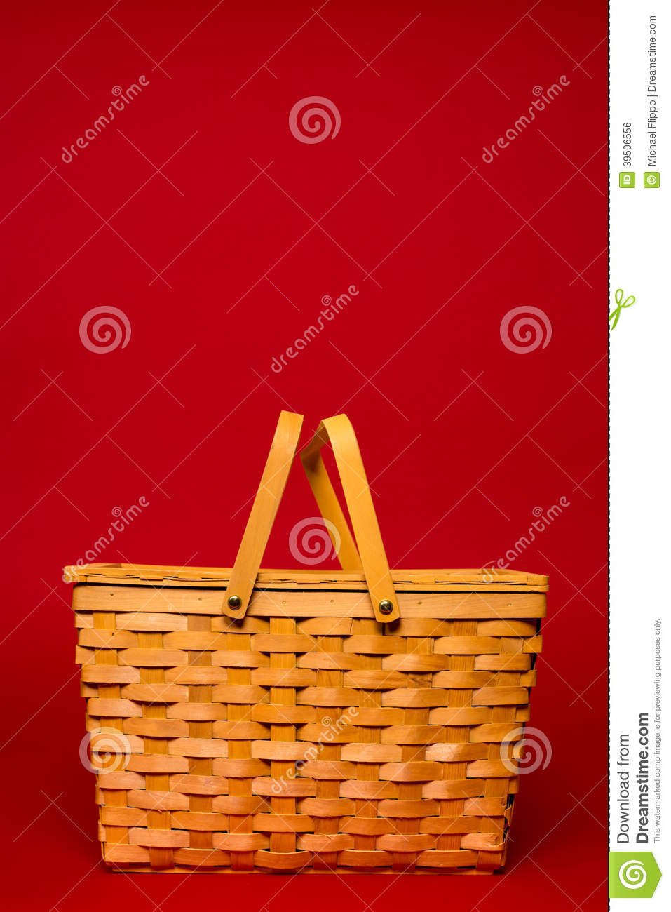 Wicker picnic basket on a red background