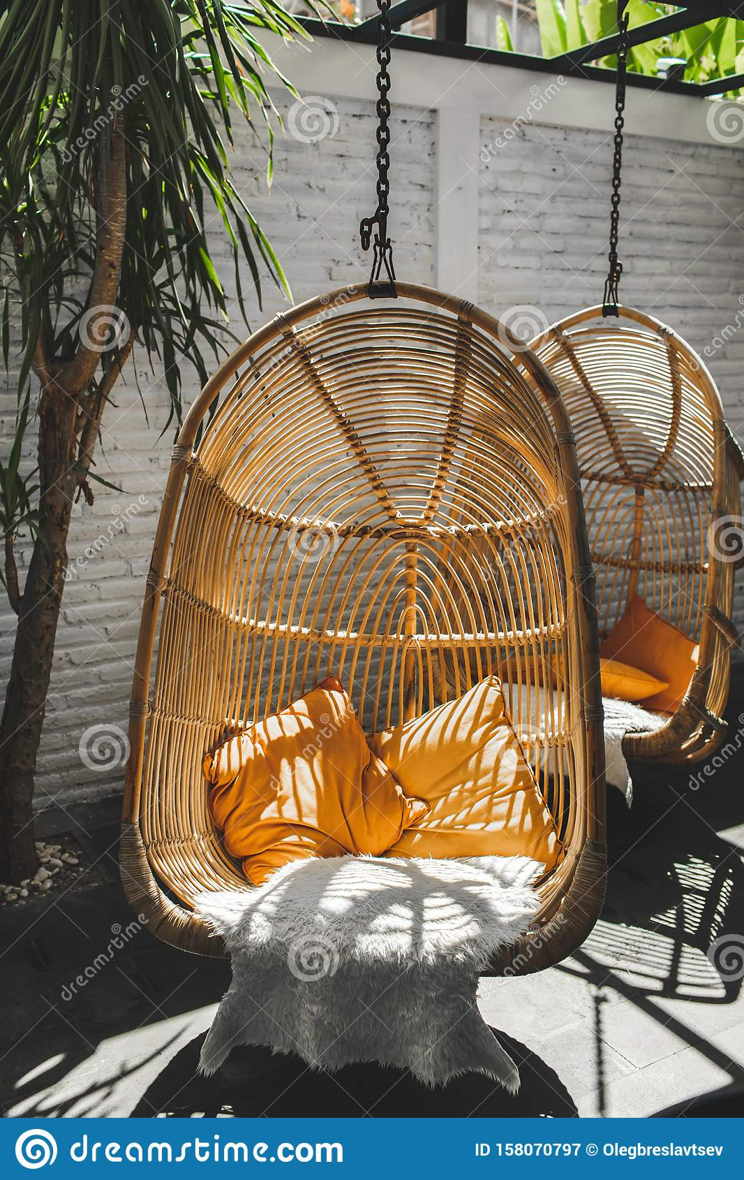 Wicker Rattan Hanging Chair In Loft Hipster Cafe Stock ...