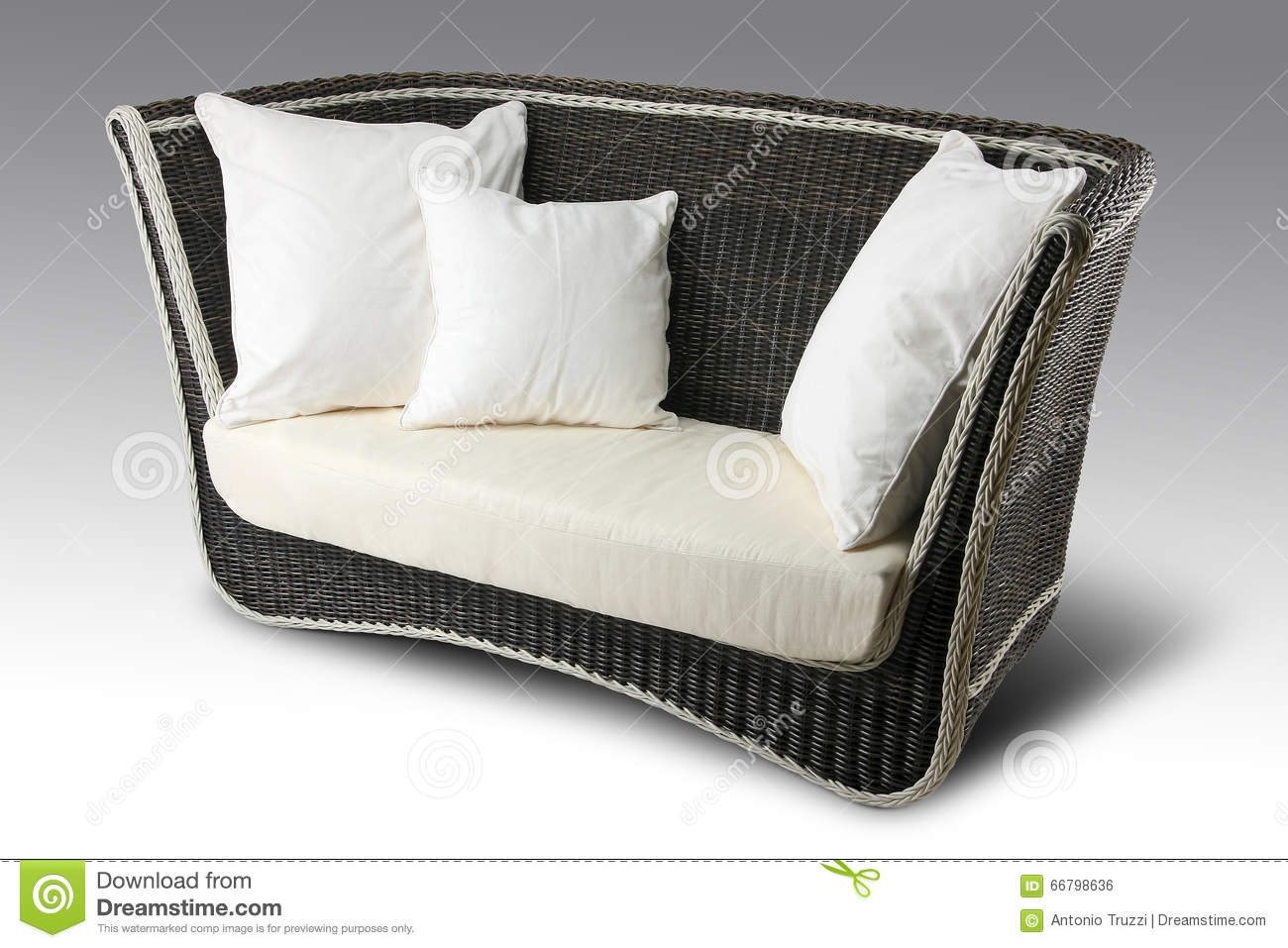 Wicker sofa with pillows