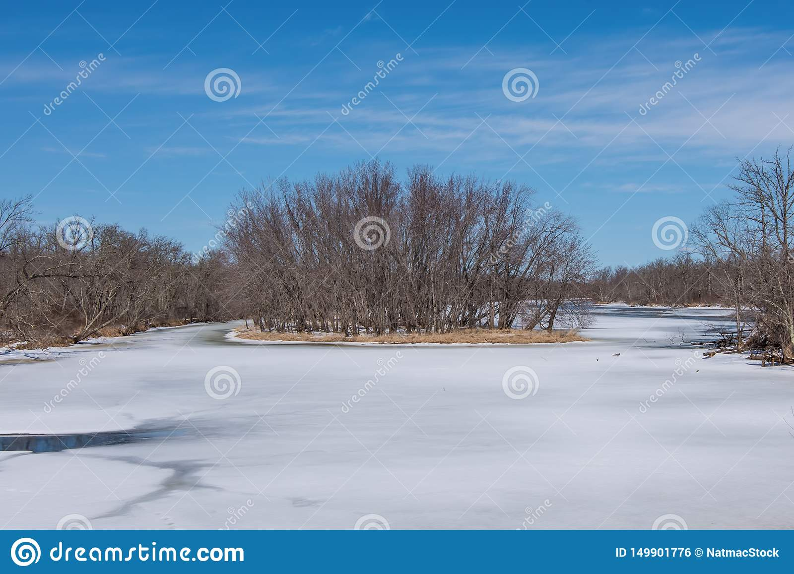 Wide angle landscape of an island in the vast St. Croix River with Wisconsin on the left shoreline and Minnesota on the right shor