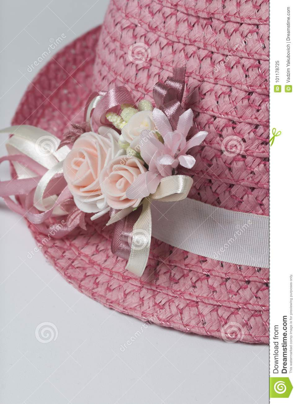 A wide brimmed female hat of coral color decorated with a a wide brimmed female hat of coral color decorated with a buttonhole artificial flowers in the form of roses mightylinksfo