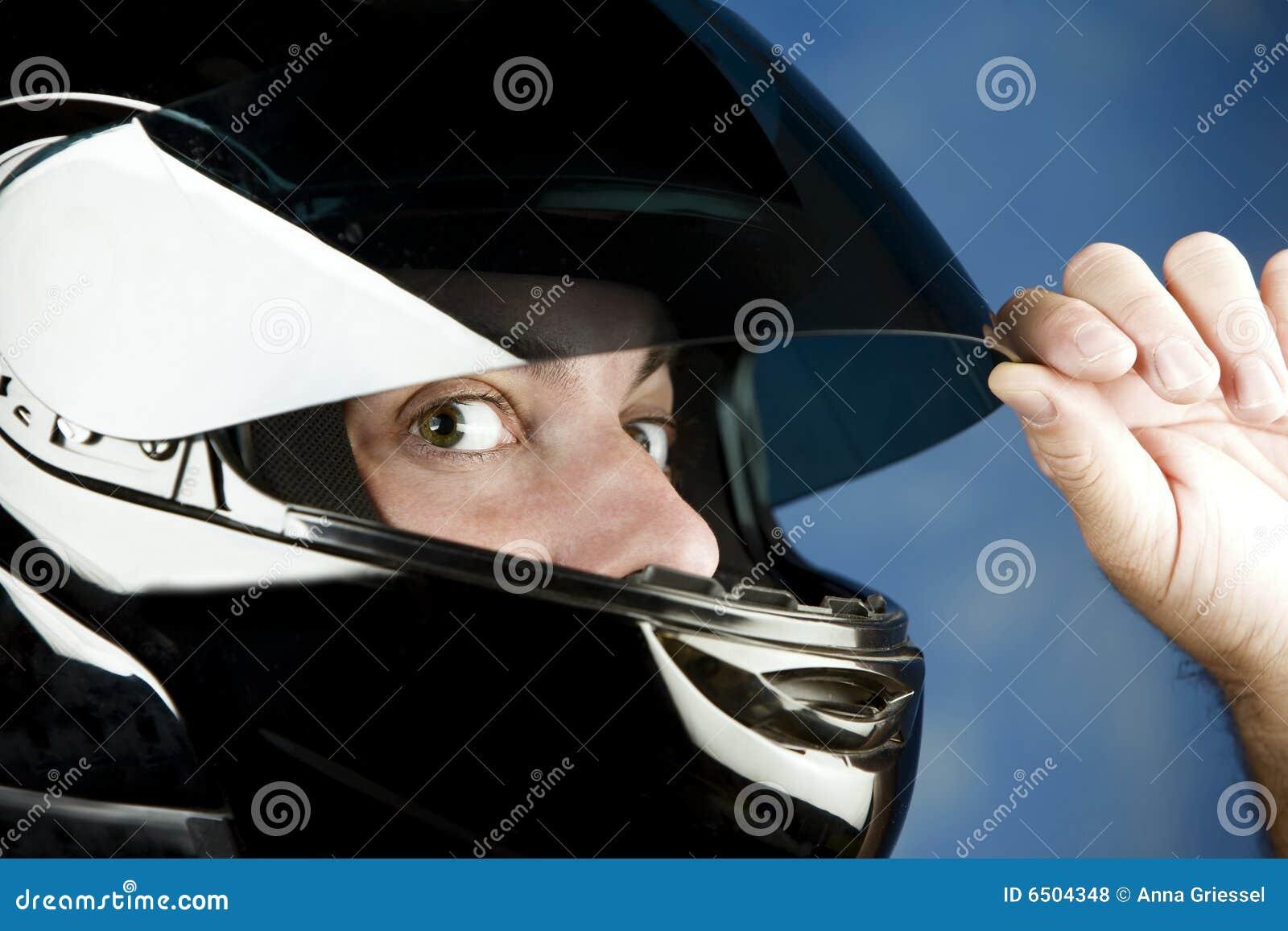 Wide-eyed man in a motorcycle helmet