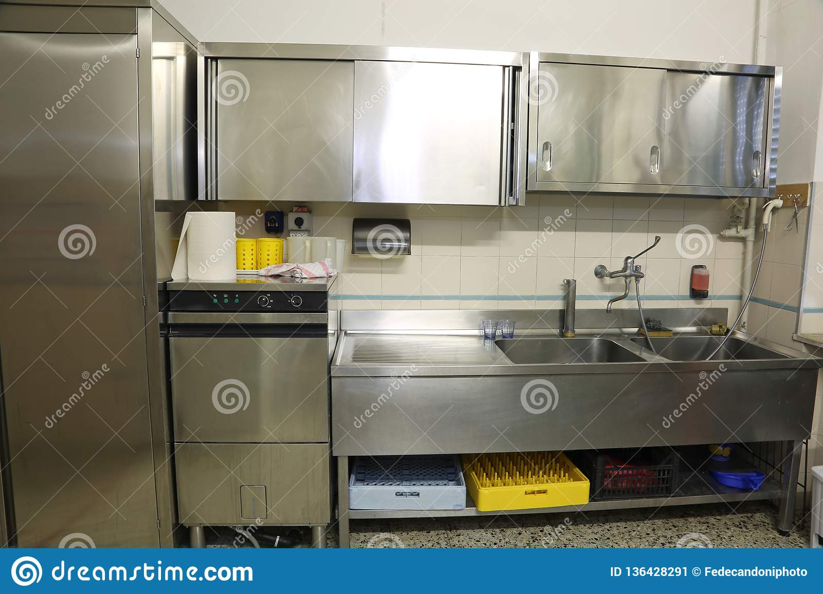 Wide Kitchen With Large Steel Sink And Industrial Dishwasher ...