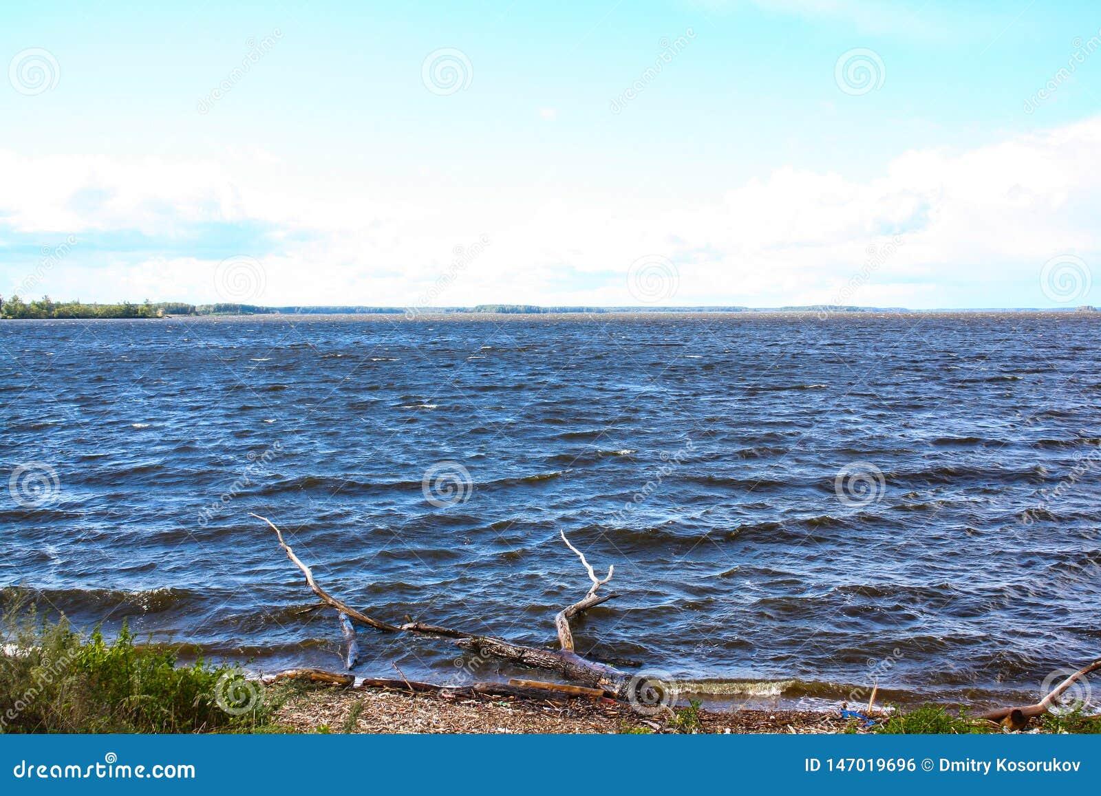 Wide river against blue sky