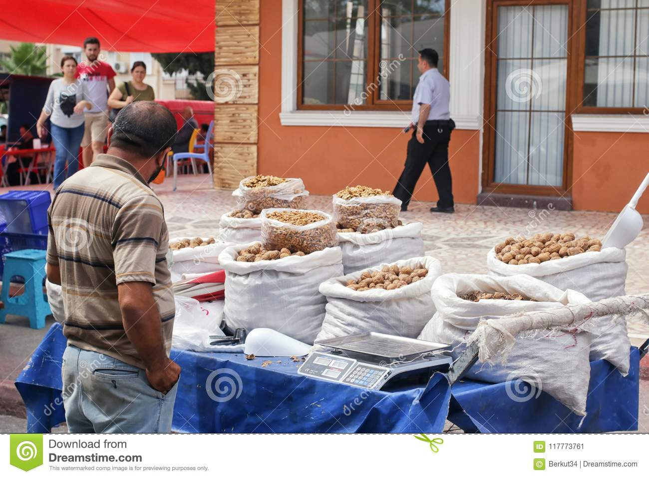 Wide variety of spices, nuts and dried fruits on the shelves of local street market traders