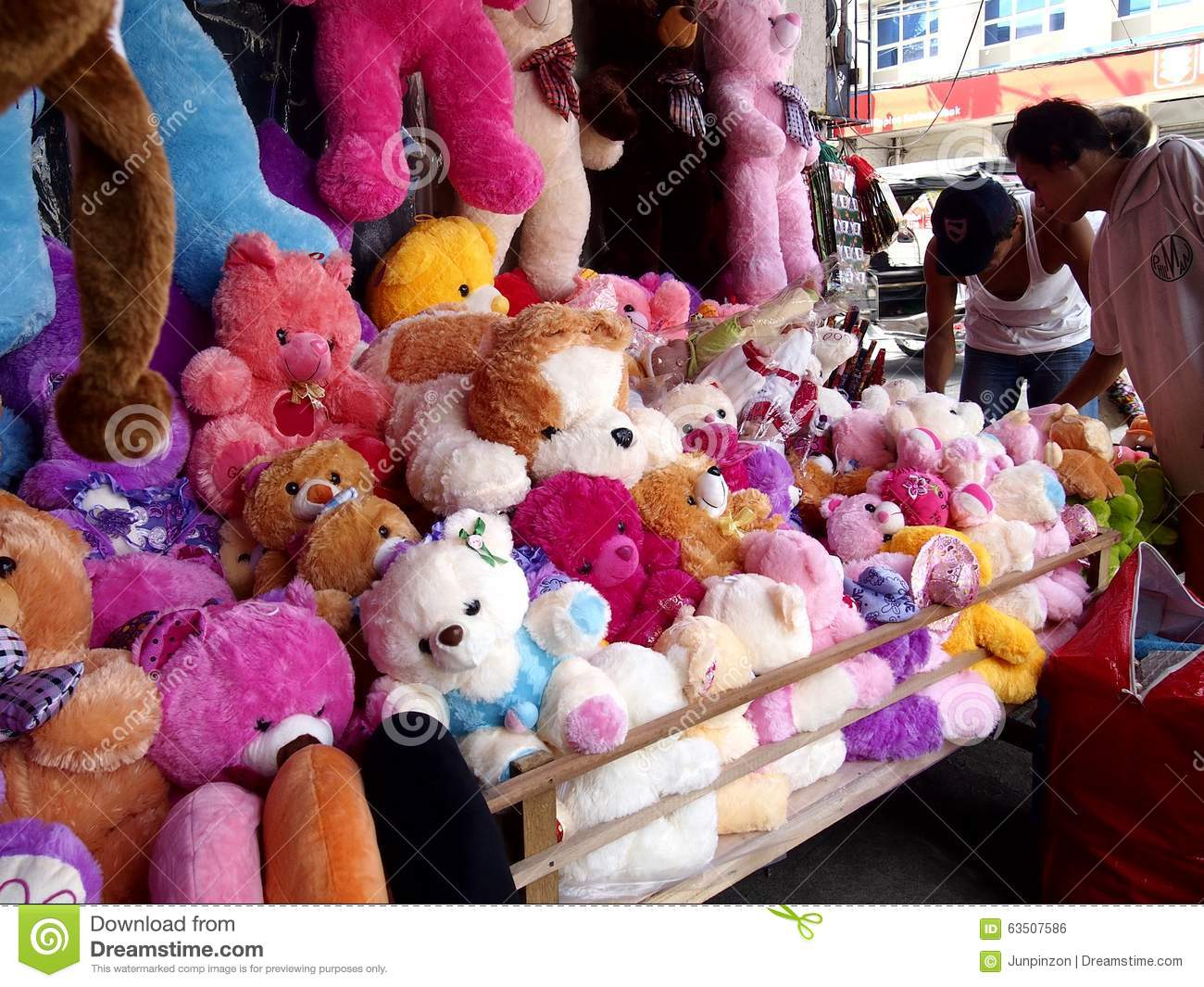 A wide variety stuffed toy animals on display