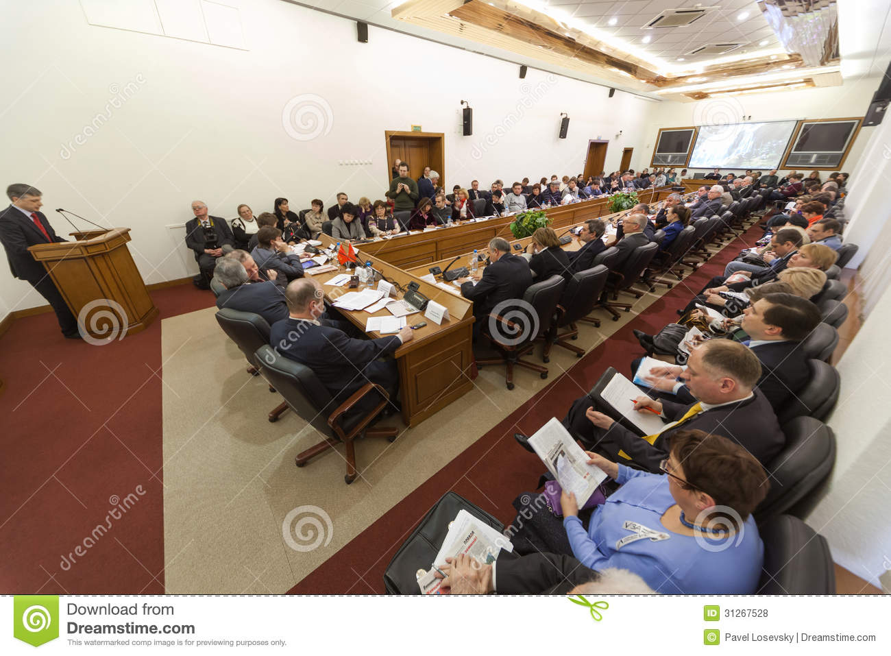 Wide view on the hall and speaker on round table elections for Table moscow