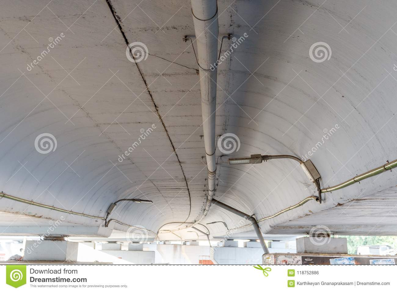 Wide view of underground of a flyover seen with lamp lights and