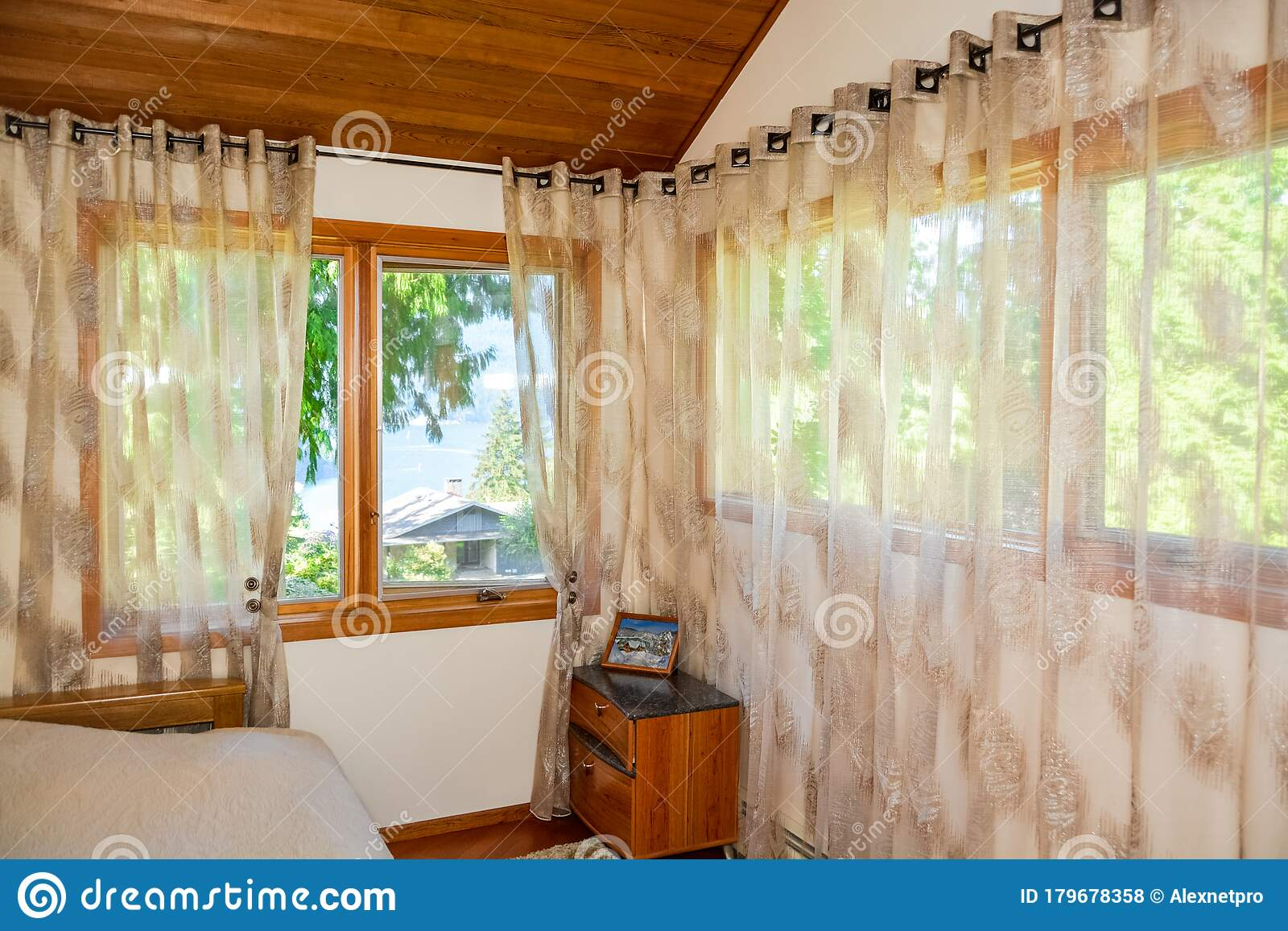 Wide Windows And Curtains In Small Bedroom With Ocean Bay View Stock Photo Image Of Real Peaceful 179678358
