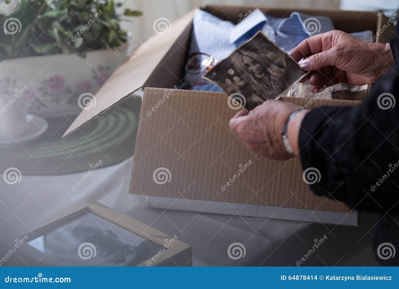 Widow packing things of husband