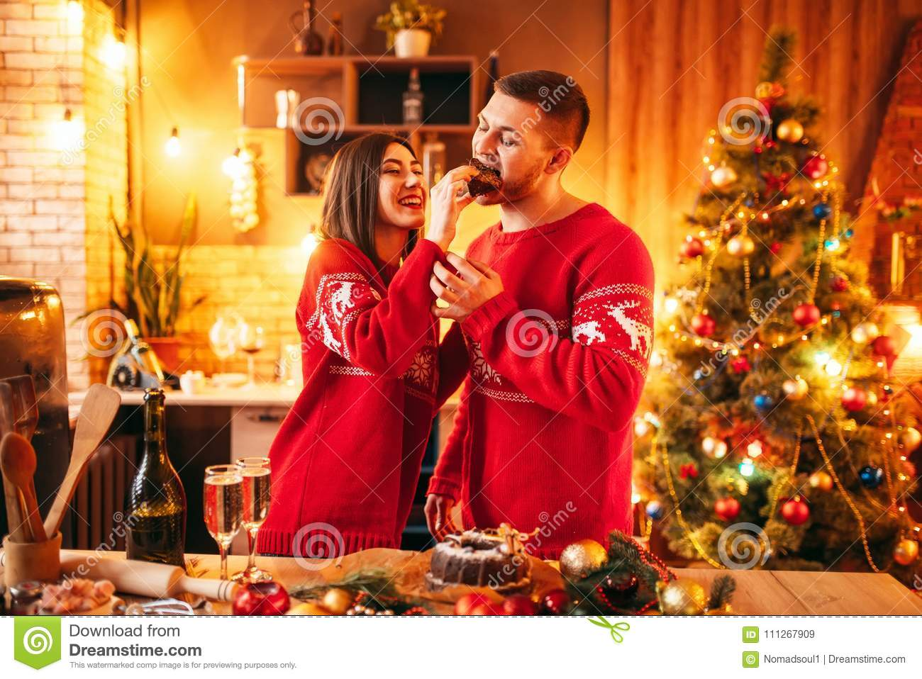 A Husband For Christmas.Wife Is Feeding Her Husband A Christmas Cake Stock Image