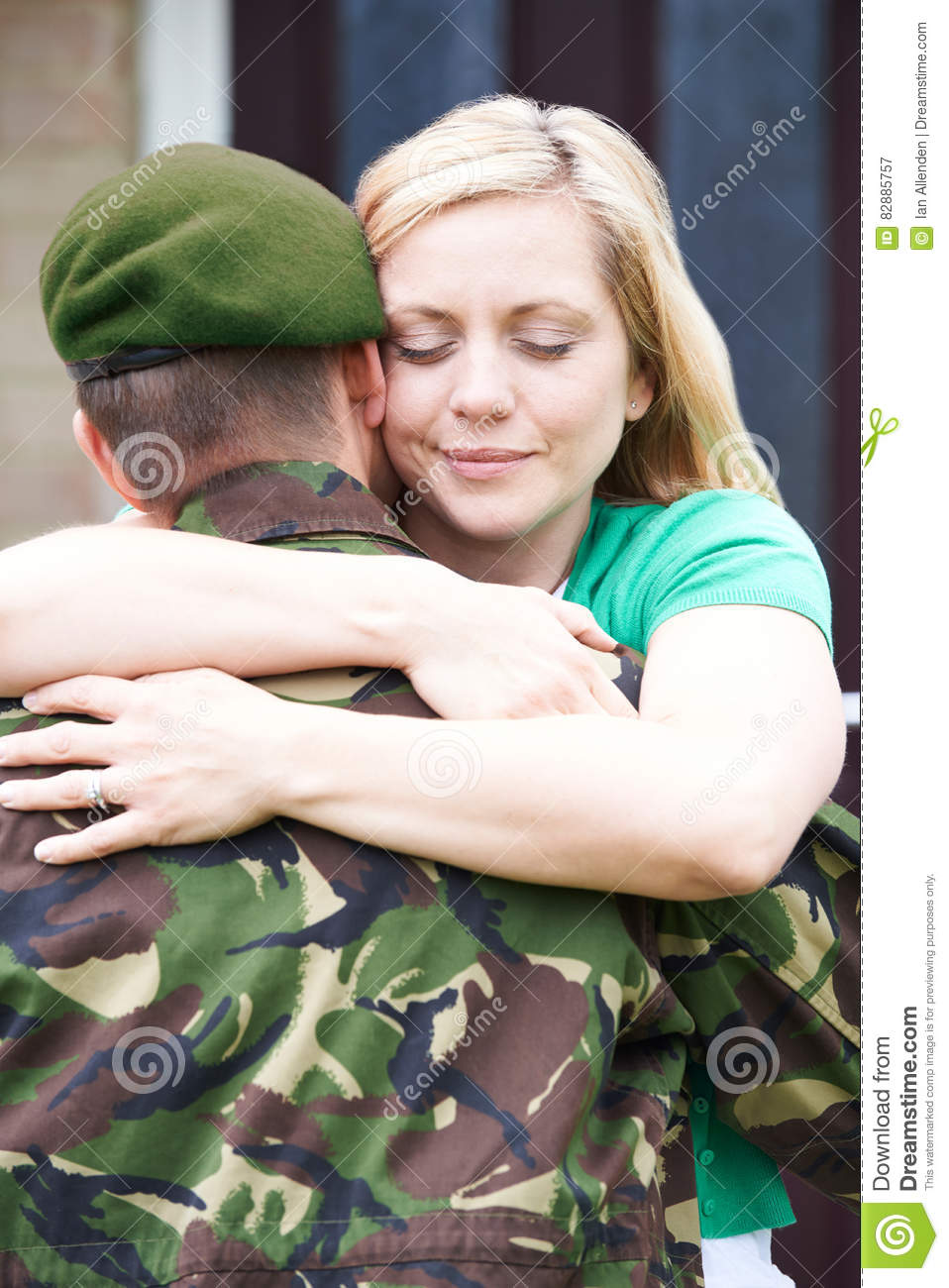 Wife Hugging Army Husband Home On Leave