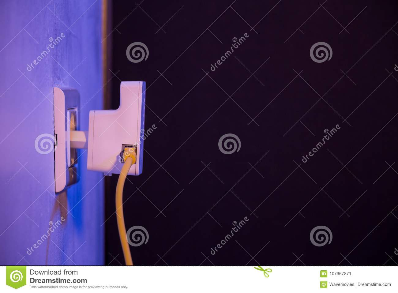 WiFi Extender In Electrical Socket On The Wall With Ethernet