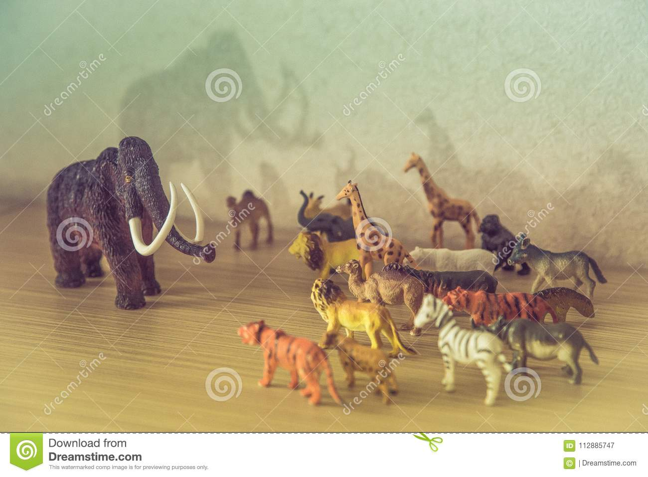 Wild animals against a huge prehistoric mammoth